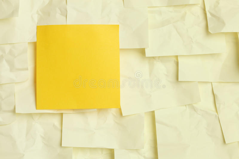 Yellow sticky note. Yellow stand out sticky note background royalty free stock photography