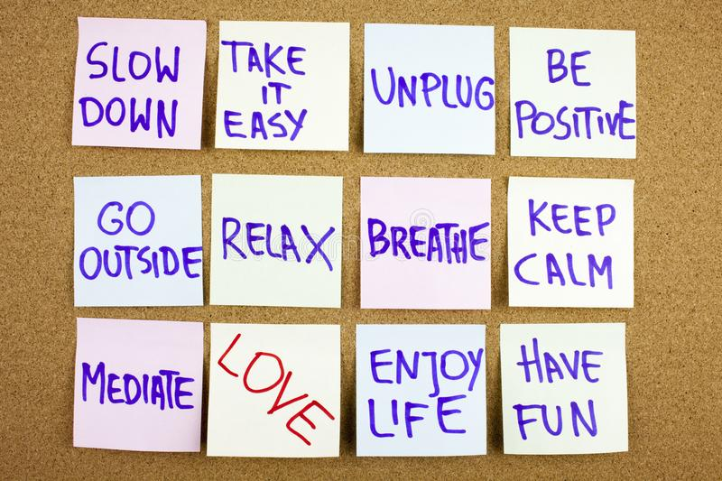 A yellow sticky note writing, caption, inscription Slow down, take ir easy be positive go outside relax breathe keep stock image