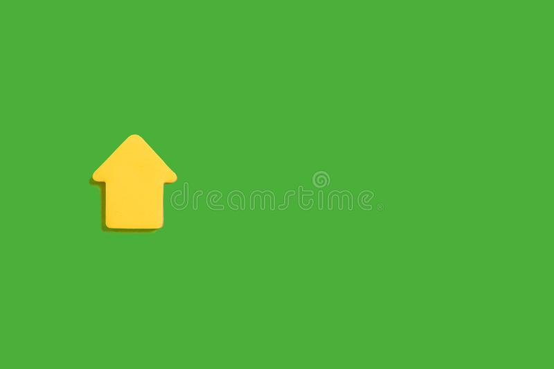 Yellow sticky notes on a green surface. Yellow sticky note block lying isolated on green background. concept of office stationary. free space for advertising stock images