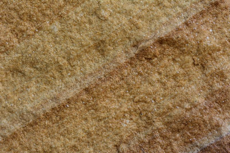 The yellow stone surface with cross line of sandy texture. Yellow stone surface with cross line of sandy texture stock photos