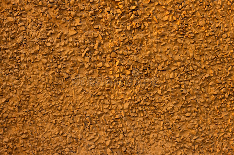 Yellow stone wall stock images