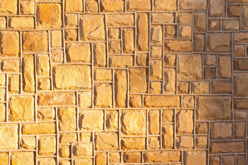 Yellow stone wall background royalty free stock photography