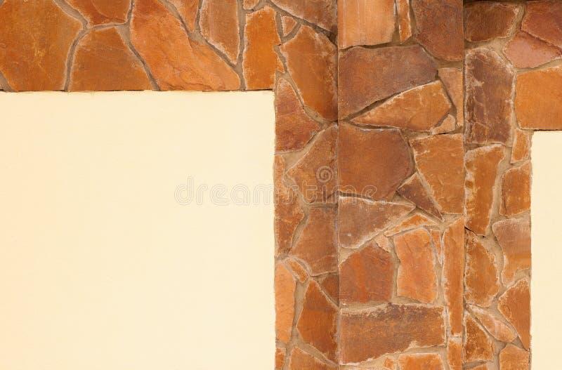 Yellow stone wall stock image