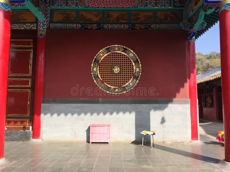 A yellow stool and a pink bedside table in the Buddhist Temple. Kunming, Yunnan, China stock photos