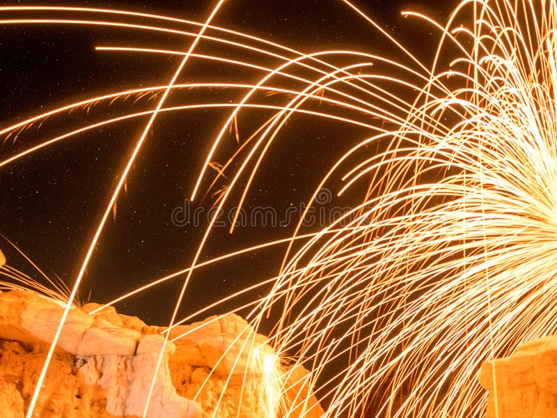 Sparks and streaks over rock formations royalty free stock photos