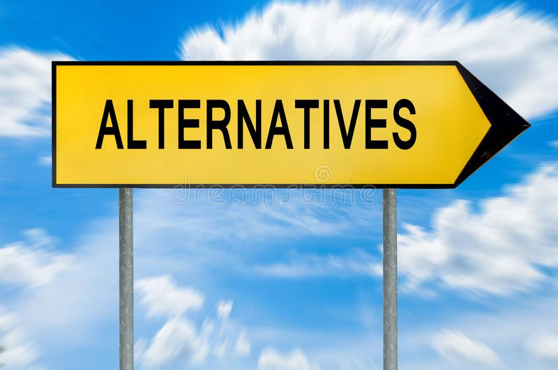 Yellow street concept alternatives sign. Isolated on sky background close stock photos
