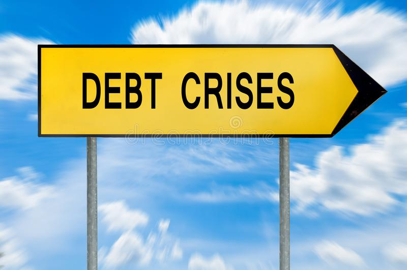 Yellow street concept debt crises sign. Isolated on sky background royalty free stock photography