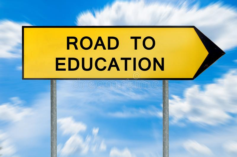 Yellow street concept road to education sign stock images
