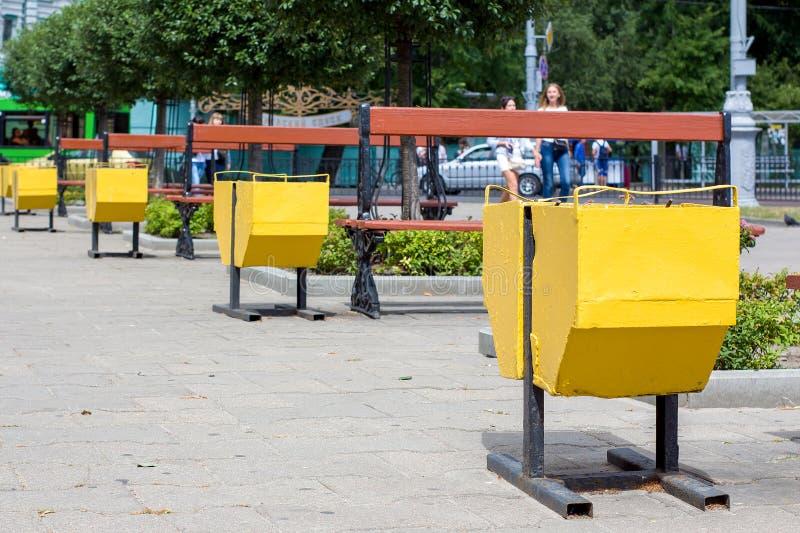 Yellow street garbage bin royalty free stock image