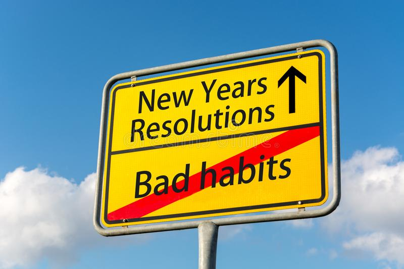 Yellow street sign with New Years resolutions ahead leaving bad. Habits behind close up royalty free stock photography