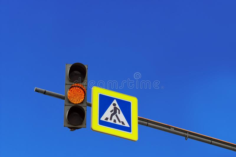 Yellow streetlight signal stock photo