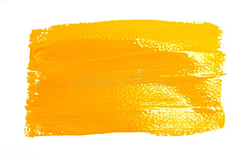 Yellow strokes of the paint brush. Isolated on a white stock images