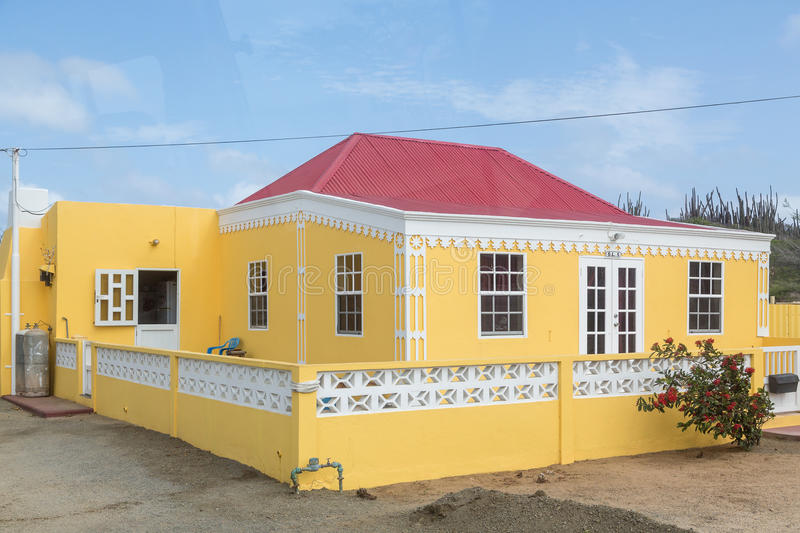 Yellow Stucco House with Red Tile Roof. Traditional yellow plaster house with red tile roof in Aruba stock images