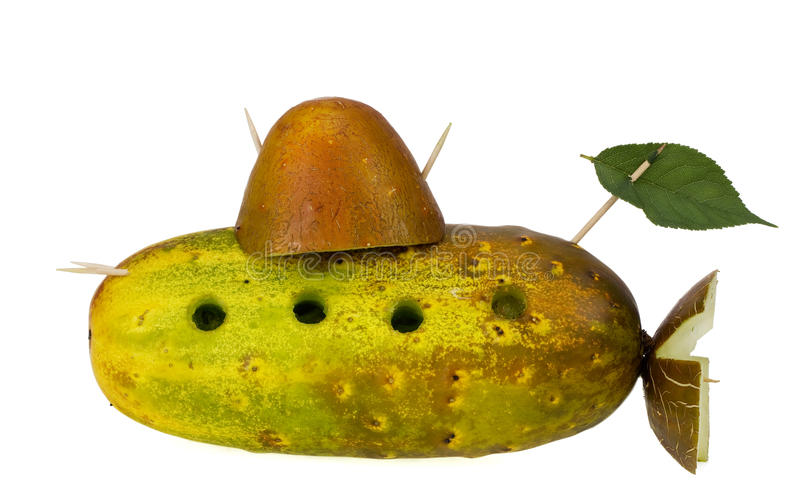 Yellow submarine. We all live in a yellow submarine concept. Collage from old cucumbers and toothpicks. Isolated stock photos