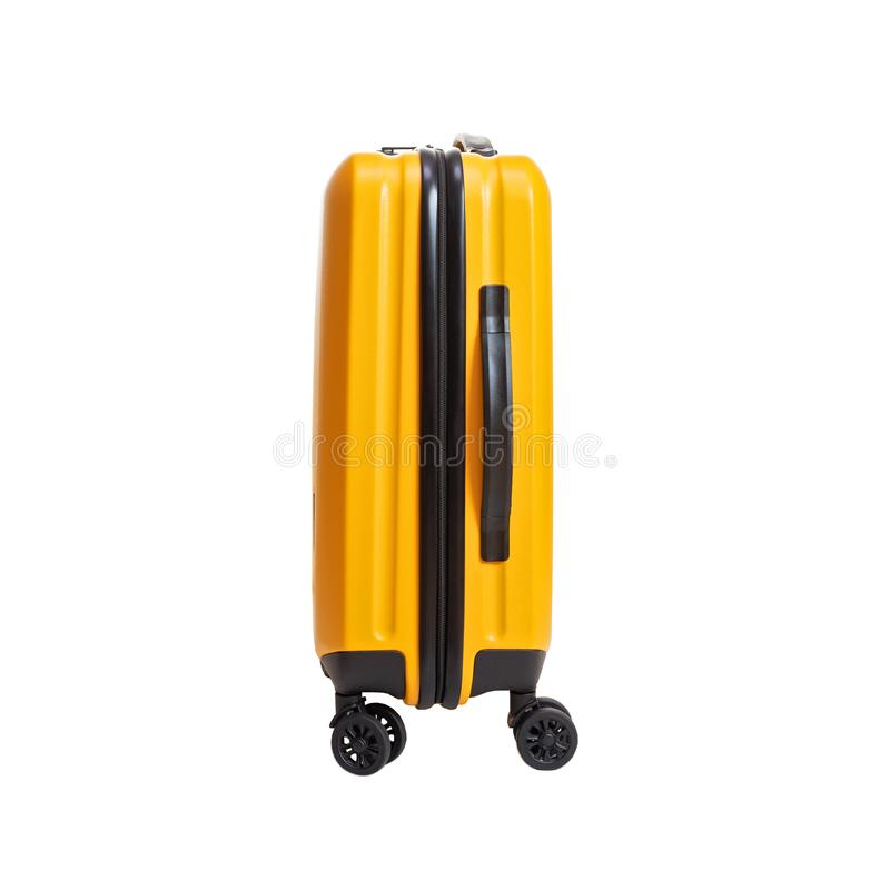 Yellow suitcase for travelling on white background stock image