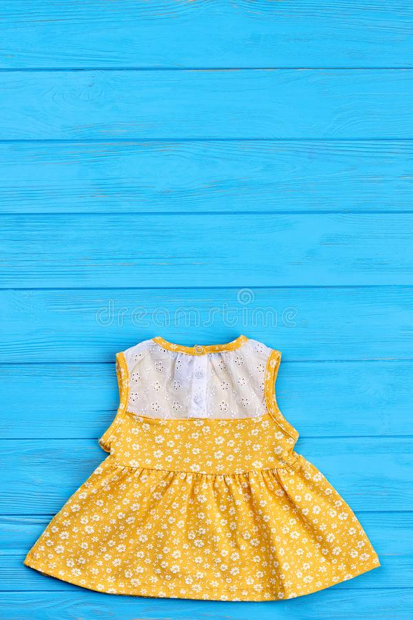 Yellow summer dress for infant girls. royalty free stock images