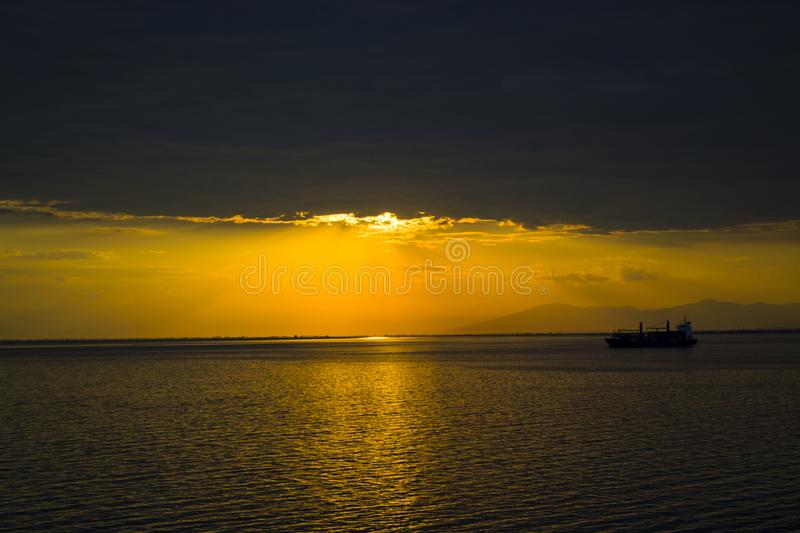 YELLOW SUNSET ANS HEAVY CLOUD royalty free stock images