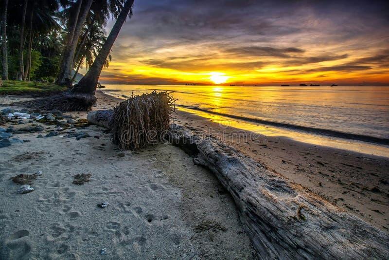 Yellow sunset. Sunset at nirawan beach stock photography