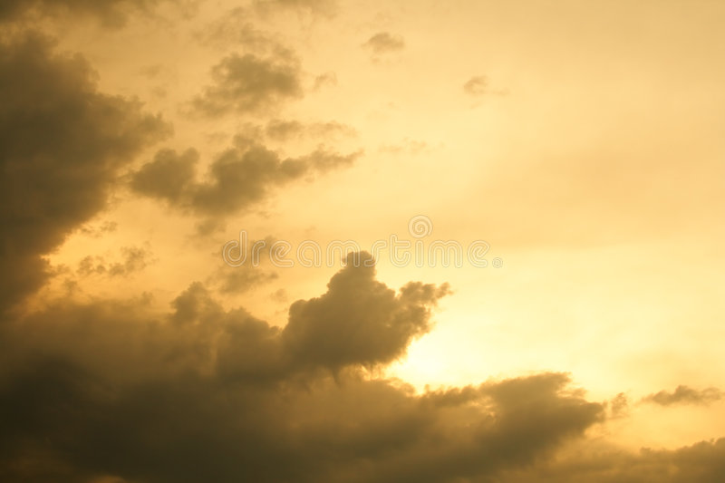 Yellow sunset rain clouds royalty free stock photography