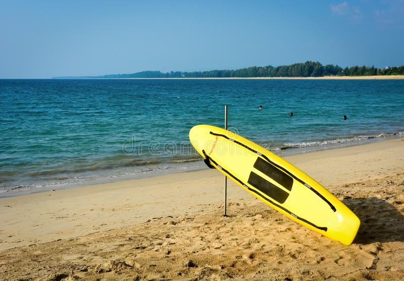 Yellow surf rescue surfboard on the beach royalty free stock photos