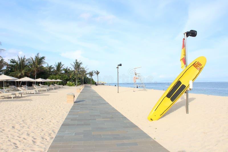 The yellow surfboard on the beach stock photos