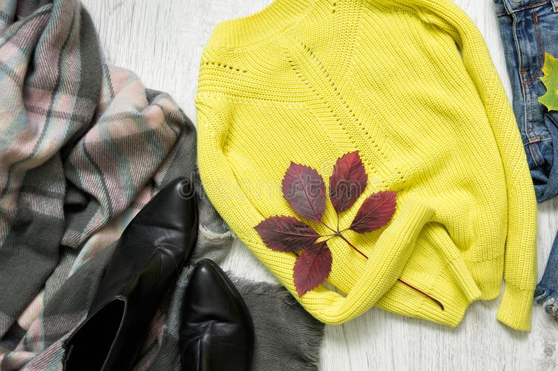 Yellow sweater, scarf and shoes. Fashionable concept.  royalty free stock photo