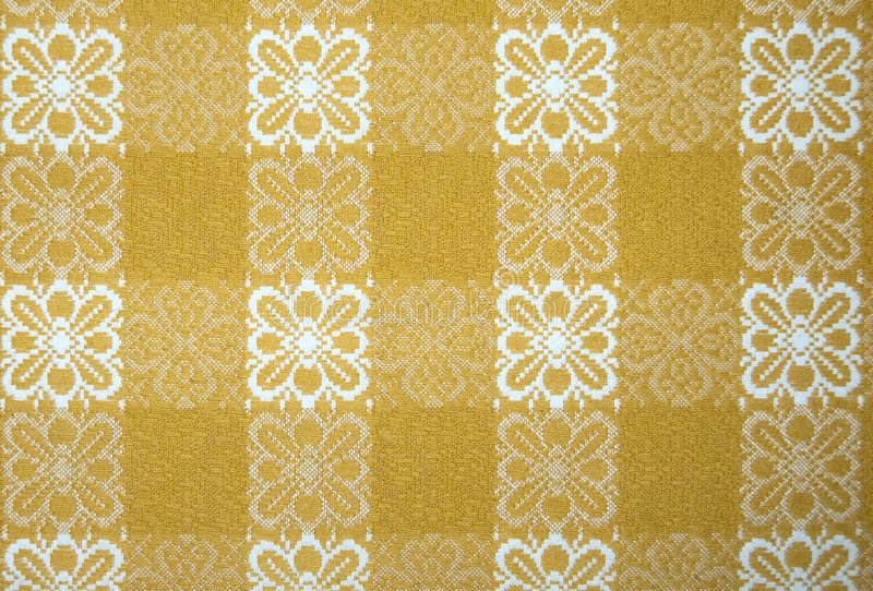 Yellow table cloth. Close up, for background use royalty free stock photos
