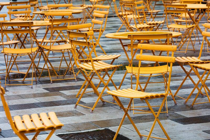 Yellow tables and chairs in a cafe stock images