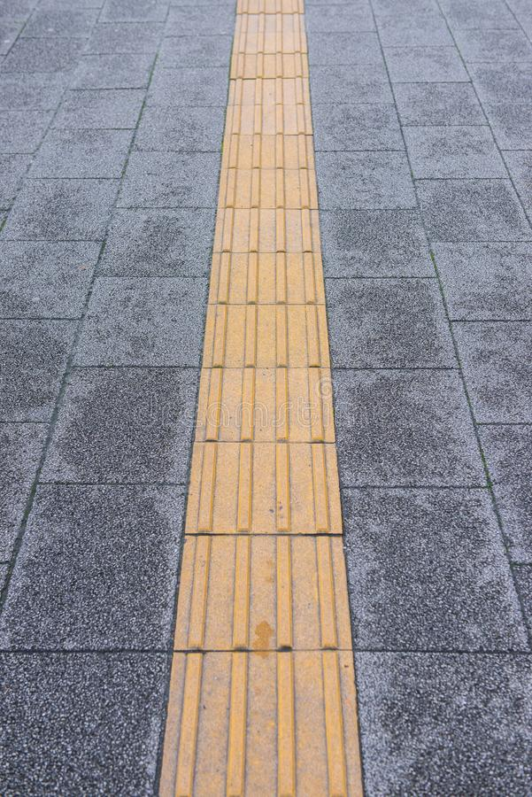 Yellow tactile paving for blind handicap royalty free stock images