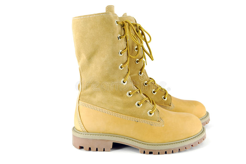 Yellow tall hiking boots stock photography