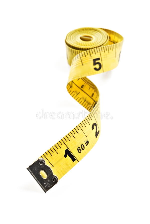 Yellow tape measure. On rolled up on white background stock images