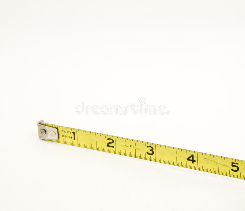 Yellow Tape Measure Five Inches. A retractable Yellow Tape Measure showing Five Inches stock photos