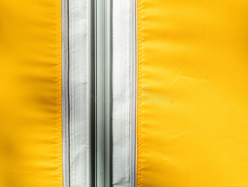 Yellow tarpaulin or polymeric fabric fastened with a zipper. Copy space royalty free stock photography