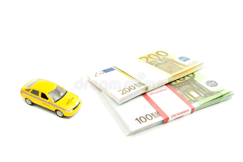 Yellow taxi car and banknotes. On white royalty free stock photography