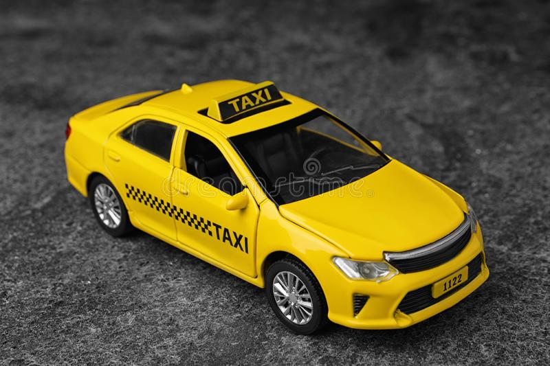 Yellow taxi car model on grey. Background stock photo