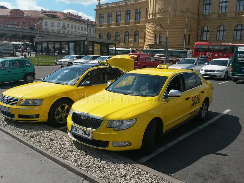 Yellow taxi cars in Prague royalty free stock image
