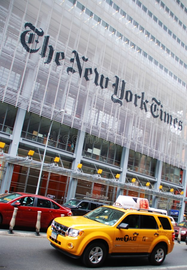 Yellow taxi outside New York Times building stock image