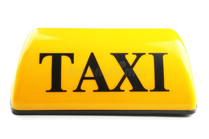 Yellow taxi roof sign on white background stock photography