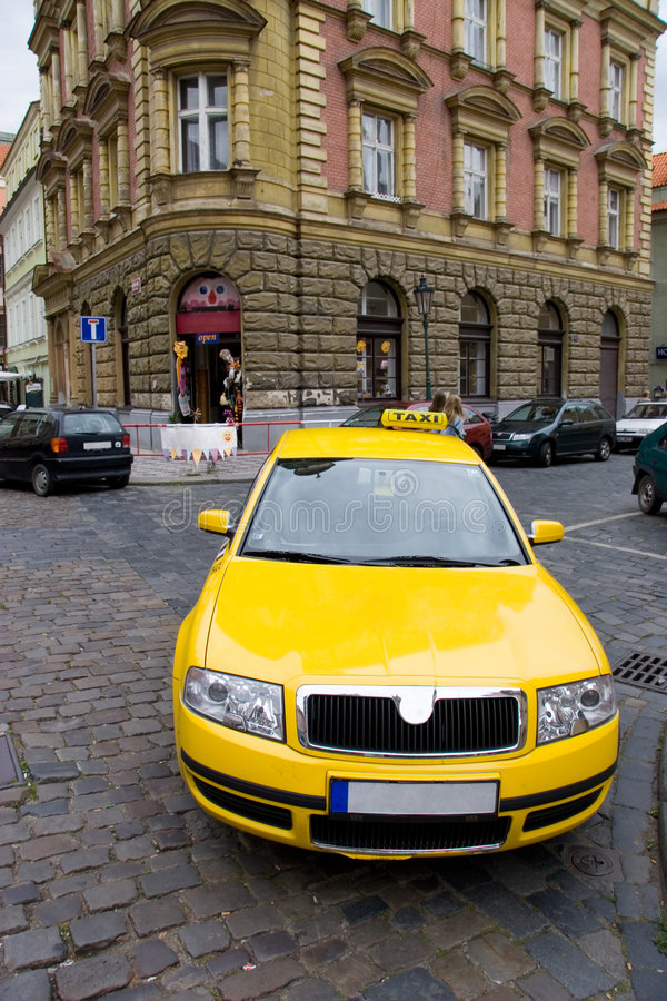 Yellow taxi wide angle view stock photo
