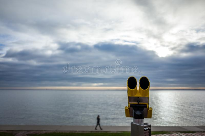 Yellow telescope at the south beach in Wilhelmshaven, Germany. Yellow telescope at the south beach in Wilhelmshaven, Germany stock photos