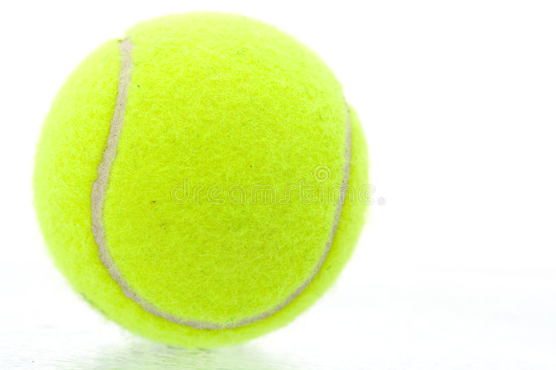Yellow tennis ball royalty free stock photo