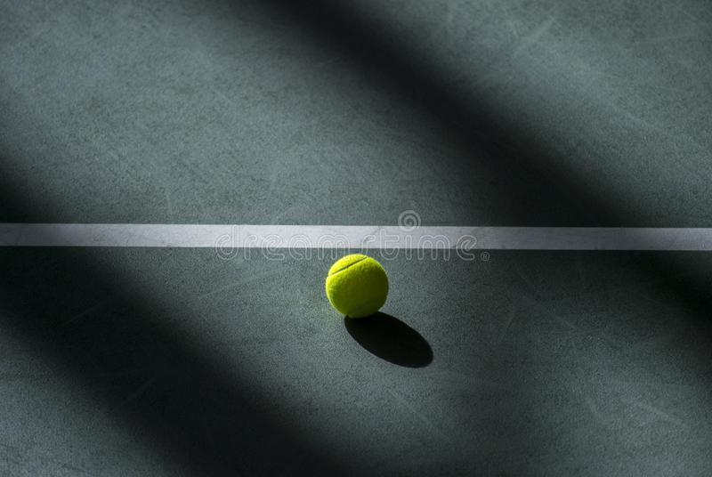 Yellow tennis ball on a field . Individual sport.  royalty free stock images