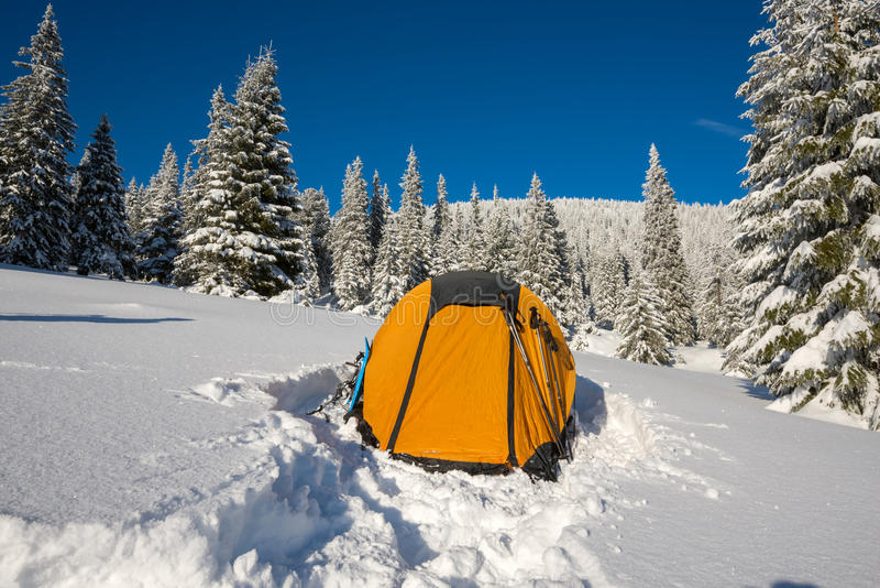 Yellow tent and equipment at alpine meadow royalty free stock photos
