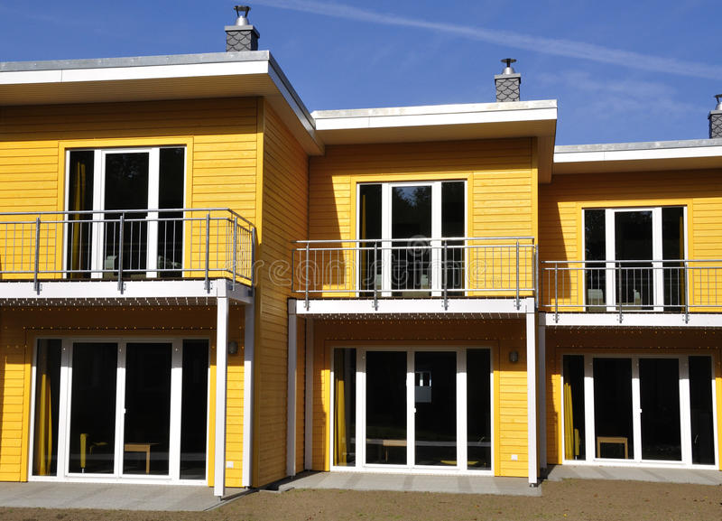 Yellow terraced house front-view royalty free stock photo