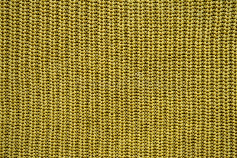 Yellow texture of a knitted English elastic pattern royalty free stock photo