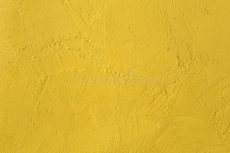 Yellow textured wall. background. Fragment of the wall with decorative plaster yellow stock photography