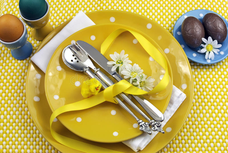 Yellow theme Easter dining table setting stock photo