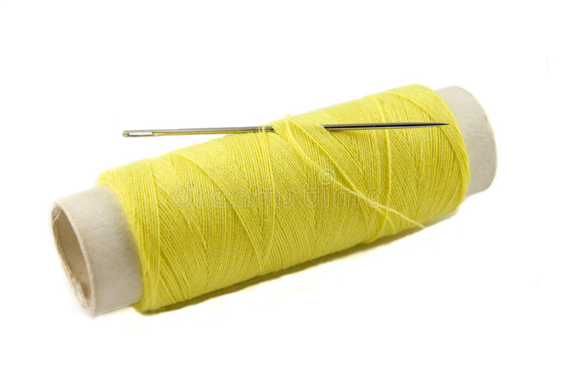Download Yellow Thread Bobbin With Needle Stock Photo - Image of nobody, closeup: 23583000