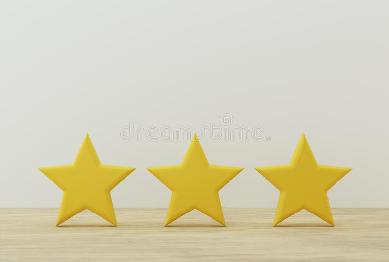 Yellow three star shape on table. The best excellent business services rating for satisfaction.  royalty free stock photo