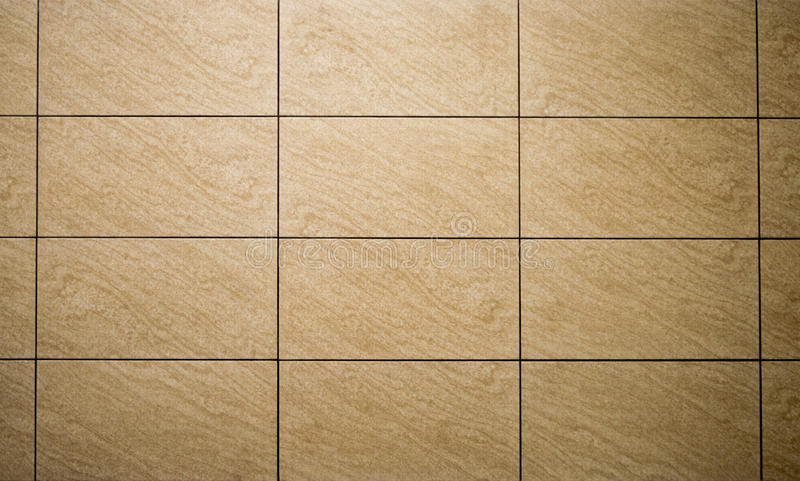 Yellow tile background. Yellow background tiles with black seams stock images